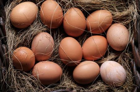 organic eggs in wicker basket fresh raw food on rustic wooden farm background Standard-Bild