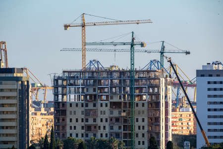 construction of building with cranes with visible internal structure