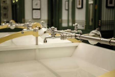 faucet and vintage toiletries marble sink public bathroom
