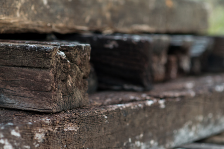 Wooden Railway sleepers background in a pile Stock Photo
