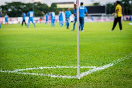 conner: green grass conner of football field