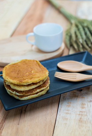 coffe cup: Pancakes and coffe cup on wooden table Stock Photo