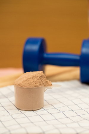 dumbell: whey protein and dumbell