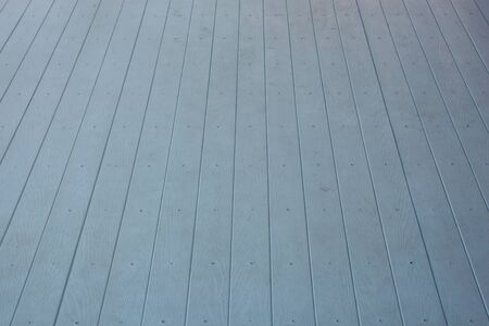 environmentally friendly: background of light wooden planks, painted with environmentally friendly colors