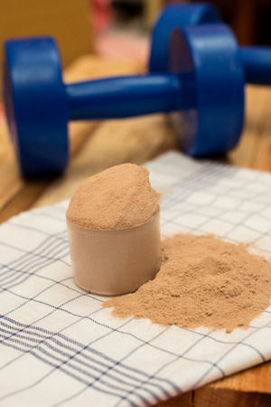 whey: whey protein and dumbell
