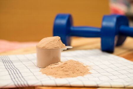 casein: whey protein and dumbell