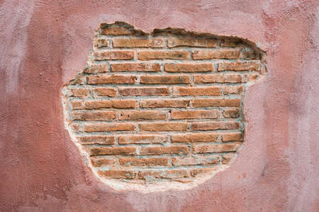 cracked wall: cracked concrete vintage brick wall background.with space for text