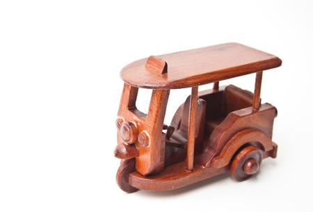 Wooden Tuk-Tuk  model isolated on white background photo