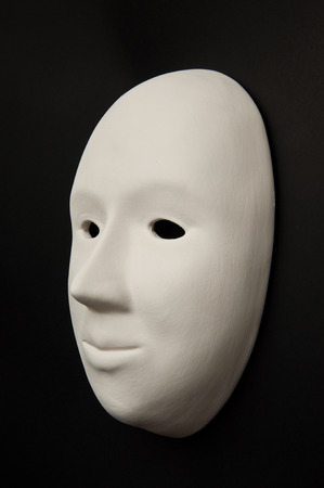 grotesque: Plaster mask isolated on black