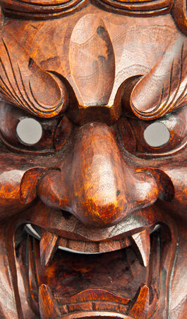 Close up japanese demon mask carving from wood