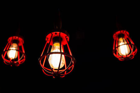 Three red-cover light bulbs photo