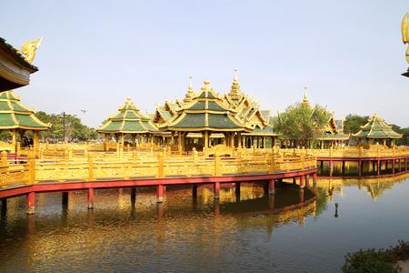 gold Big pavilion on water photo