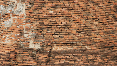 weed block: old brick wall background in thailand