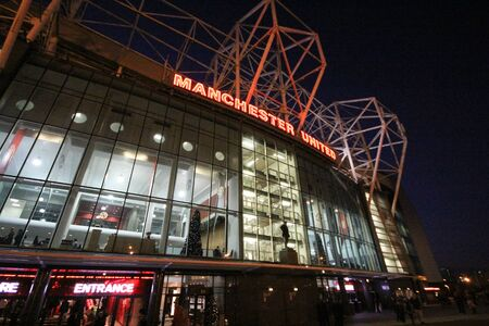 MANCHESTER, ENGLAND-December 5 ,2013:In front of the Manchester United Stadium or Old Trafford Stadium is most famous for football. Redactioneel