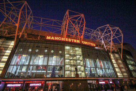 MANCHESTER, ENGLAND-December 5, 2013: In front of the Manchester United Stadium or Old Trafford Stadium is most famous for football.