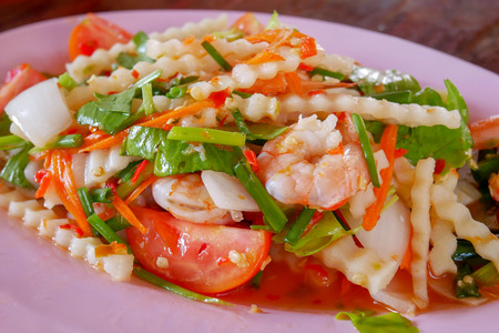 Spicy Shrimp and Coconut Shoot Salad on pink dish