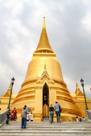 Bangkok, Thailand - October 8, 2010: Gold pagoda in side wat phra kaew people visit because the beautiful at thailand 新聞圖片