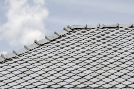 the gray roof and sky in thailand Stock Photo