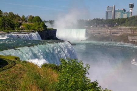 NIAGARA FALLS, New York - JUNE 12,2018: People Visitors on Niagara Falls is the waterfalls  New York ,USA. Reklamní fotografie - 133985109