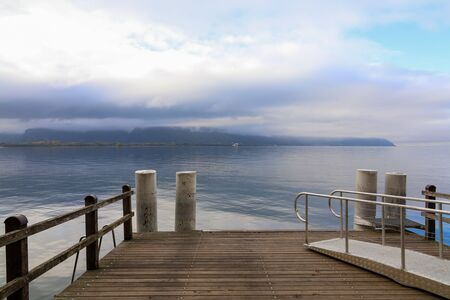 View of pier in front of  Lake Geneva in autumn season at Montreux ,switzerland Standard-Bild