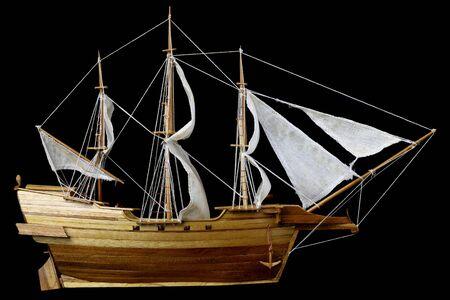 Wood battle ship model on black background