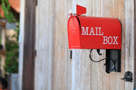 standard steel: red mail box on wood texture