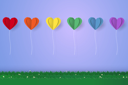 folded paper: Colorful heart balloons flying over grass, paper art style