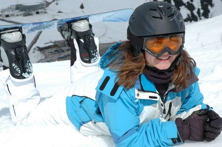 Laughing snowboarding Girl photo