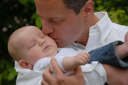 Familyfather holding sleeping baby