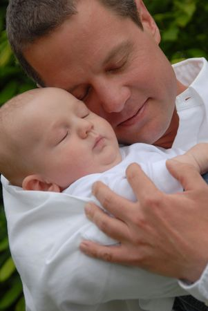 Familyfather holding sleeping baby Stock Photo - 5614296