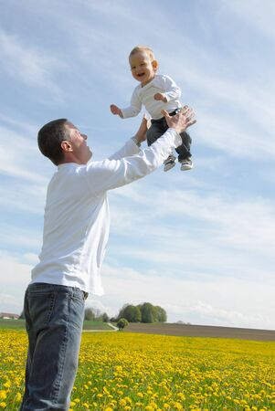 Father lifting his son up in the sky