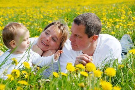 location shot: Young Family with Toddler in Dandelion Field