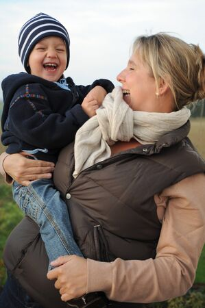 Laughing boy on his mother s arm photo