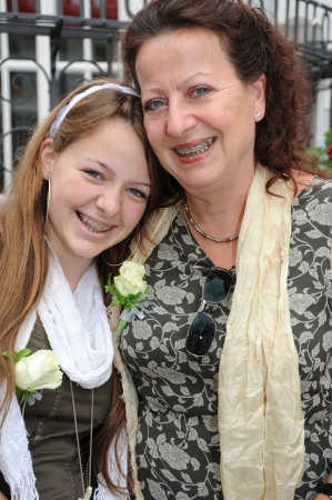 braces: Mother - daughter laughing portrait with braces Stock Photo