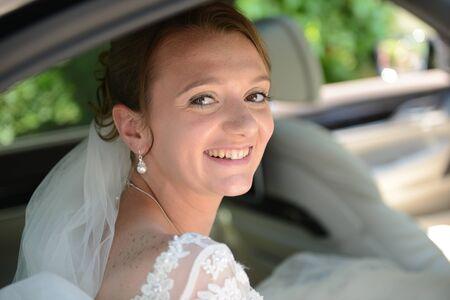 Bride in bridal car looking into the camera Stock Photo