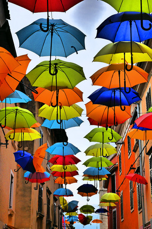 colorful umbrellas hanging on a street in Novigrad