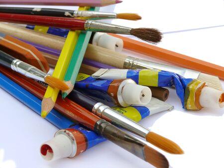 pensils: Paintbrushes, pensils, acrylic paints.