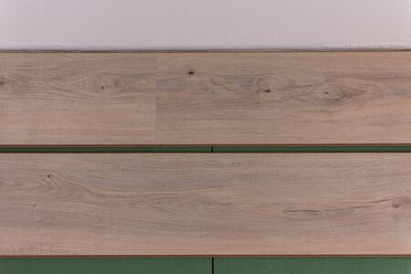 Installation laminate in the room, sheets environmentally friendly underfloor and laminate or parquet