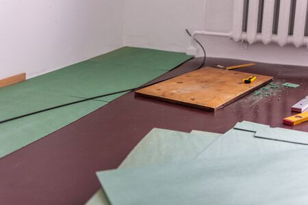 Sheets environmentally friendly underfloor for laminate and parquet , rulers and knife for cutting the underfloor, natural insulation from coniferous species Stok Fotoğraf