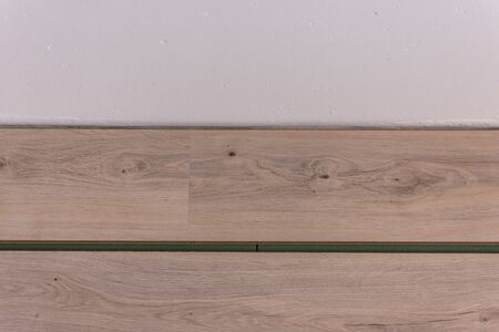 Installation laminate in the room, sheets environmentally friendly underfloor and laminate or parquet Stockfoto
