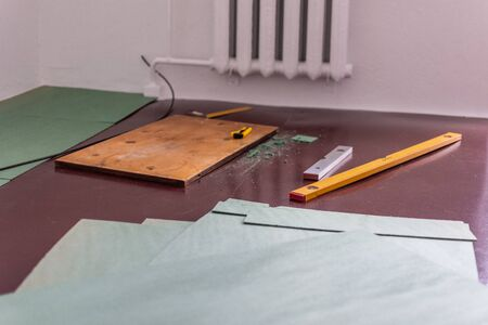 Sheets environmentally friendly underfloor for laminate ,rulers and knife for cutting the underfloor,natural insulation from coniferous species