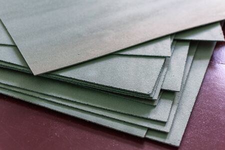 Sheets environmentally friendly underfloor for laminate and parquet are stacked on the floor, natural insulation from coniferous species