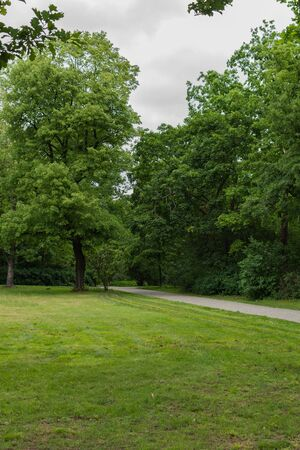 Walk on a warm sunny day in the park Volkspark Friedrichshain in Berlin, cozy paths and green lawns