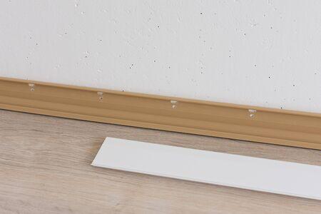 Installing plastic skirting board in the room, repair work in the house Stok Fotoğraf