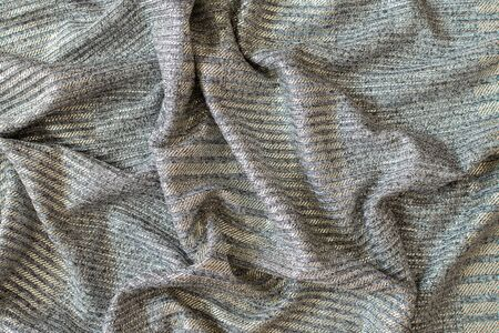 Abstract background of bright shiny silvery fabric Reklamní fotografie