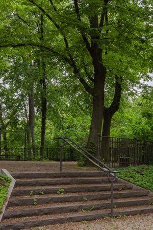 Walk on a warm sunny day in the park Volkspark Friedrichshain in Berlin, stone stairs
