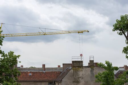 Repair restoration work in an old house in Berlin, crane with window frame