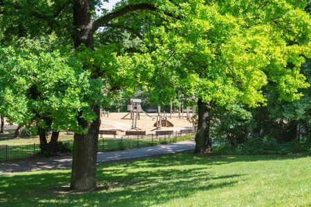 Walk on a warm sunny day in the park Volkspark Friedrichshain, playground in the park, Berlin