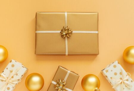 Festive background with gold decoration, gold background with gift boxes and christmas balls, flat lay, top view