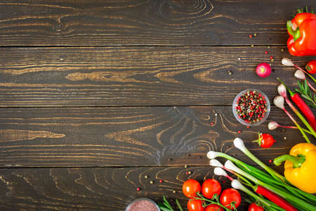 Tasty juicy ripe vegetables with spices on wooden background, vegetable background, healthy eating concept